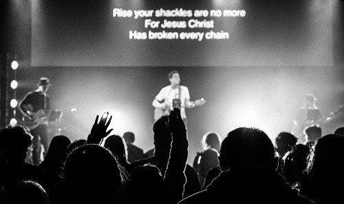 Image of worship singing in church